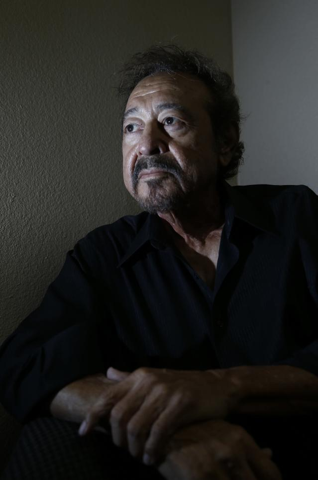 Joe Atencio is photographed at his real estate business Wednesday, Sept. 13, 2017, in Phoenix. Atencio's son was killed in a 2011 altercation with former Sheriff Joe Arpaio's jail officers, who were accused of shooting him with a Taser and beating him as officers held him down and he cried out in pain. Atencio is among several people who say they were victimized by Arpaio and are upset at the pardon by President Donald Trump. (AP Photo/Ross D. Franklin)