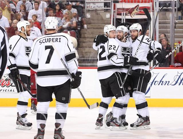 GLENDALE, AZ - MAY 15: Drew Doughty #8 of the Los Angeles Kings (2nd from R) celebrates with Jarret Stoll #28 and Trevor Lewis #22 after Doughty's shot was deflected in for a goal by teammate Dwight King #74 (far Left) against the Phoenix Coyotes in the first period of Game Two of the Western Conference Final during the 2012 NHL Stanley Cup Playoffs at Jobing.com Arena on May 15, 2012 in Phoenix, Arizona. (Photo by Christian Petersen/Getty Images)