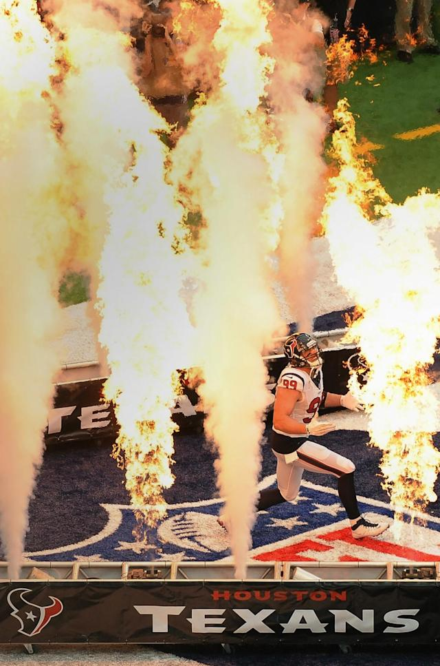 <p>Houston Texans defensive end J.J. Watt (99) runs through a wall of smoke and flames as he is introduced before an NFL football game, against the Chicago Bears Sunday, Sept. 11, 2016, in Houston. (AP Photo/George Bridges) </p>