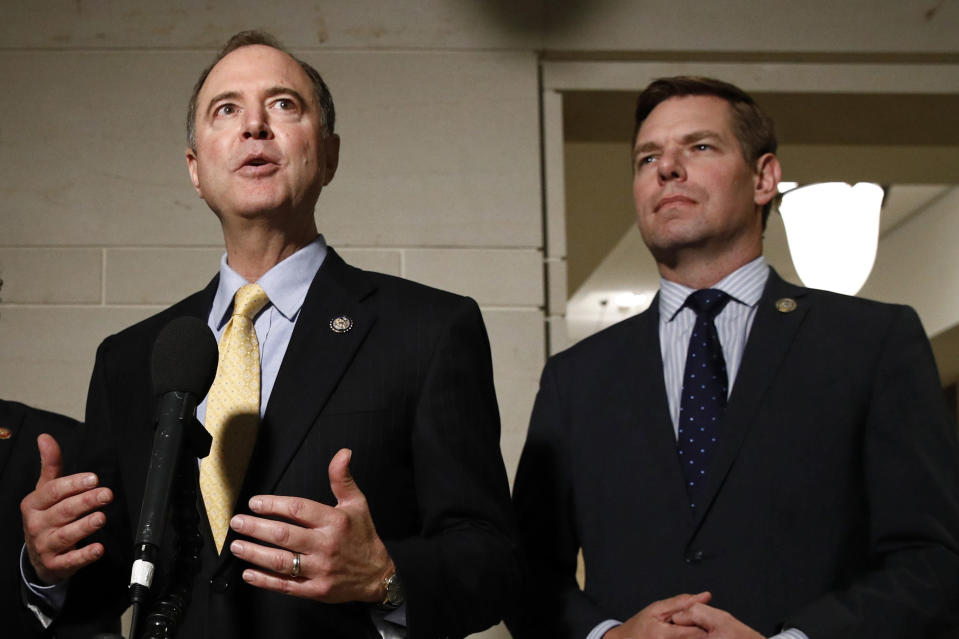 FILE - In this May 28, 2019 file photo, Rep. Adam Schiff, D-Calif., left, and Rep. Eric Swalwell, D-Calif., speak with members of the media on Capitol Hill in Washington. The Justice Department under former President Donald Trump secretly seized data from the accounts of at least two Democratic lawmakers in 2018 as part of an aggressive crackdown on leaks related to the Russia investigation and other national security matters, according to three people familiar with the seizures. (AP Photo/Patrick Semansky)
