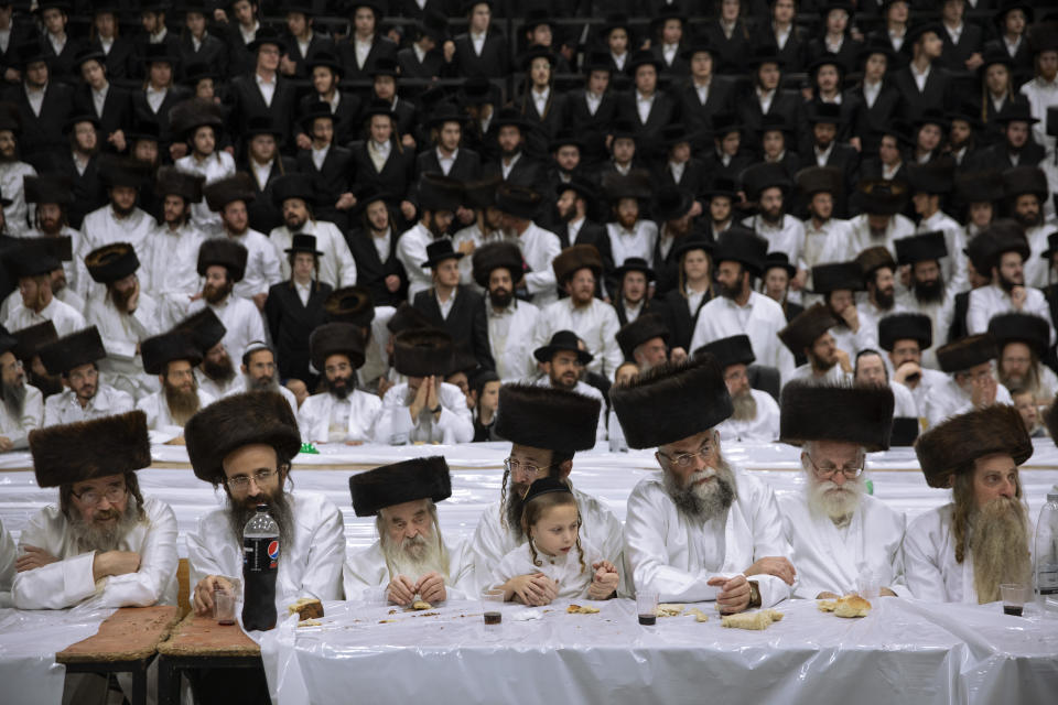 """Ultra-Orthodox Jews, members of the Lelov Hassidic dynasty attend the """"Pidyon Haben"""" ceremony of the great grandchild of their chief rabbi Aharon Biderman in Beit Shemesh, Israel, Thursday, Sept. 16, 2021. The Pidyon Haben, or redemption of the firstborn son, is a Jewish ceremony hearkening back to the biblical exodus from Egypt. (AP Photo/Oded Balilty)"""