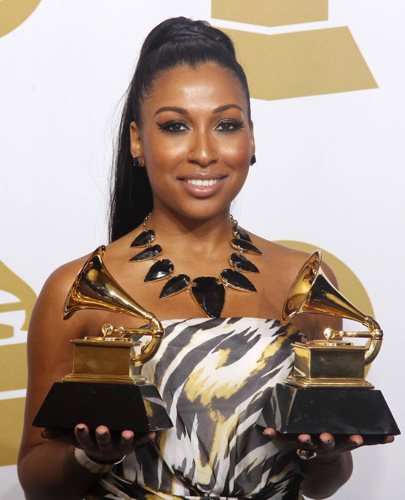 "Singer Melanie Fiona holds her awards for Best R&B Song and Best Traditional R&B Performance (""Fool For You"") at the 54th annual Grammy Awards in Los Angeles, California February 12, 2012. REUTERS/Lucy Nicholson (UNITED STATES - Tags: ENTERTAINMENT) (GRAMMYS-BACKSTAGE)"