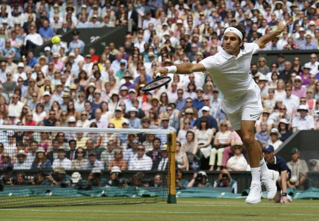 Roger Federer of Switzerland hits a return during his men's singles final tennis match against Novak Djokovic of Serbia at the Wimbledon Tennis Championships, in London July 6, 2014. REUTERS/Sang Tan/Pool (BRITAIN - Tags: SPORT TENNIS)