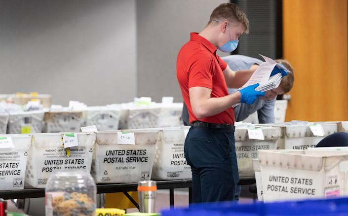 Processing absentee ballots on April 8, 2020, in downtown Milwaukee.