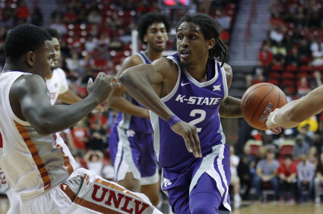 Kansas State's Cartier Diarra (2) drives into UNLV's Amauri Hardy during the second half of an NCAA college basketball game Saturday, Nov. 9, 2019, in Las Vegas. (AP Photo/John Locher)