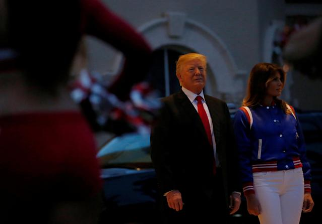 U.S. President Donald Trump and first lady Melania Trump watch the Florida Atlantic University Marching Band before hosting a Super Bowl LII watch party at Trump International Golf Club in Palm Beach, Florida U.S., February 4, 2018. REUTERS/Leah Millis