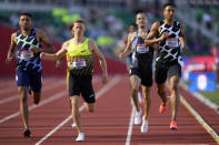 Donavan Brazier, right, wins the second heat of the men's 800-meter run at the U.S. Olympic Track and Field Trials Friday, June 18, 2021, in Eugene, Ore. (AP Photo/Ashley Landis)