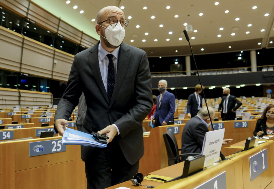 European Council President Charles Michel arrives ahead of addressing MEP's on a report of last weeks EU summit during a plenary session at the European Parliament in Brussels, Wednesday, Oct. 21, 2020. (Olivier Hoslet, Pool via AP)