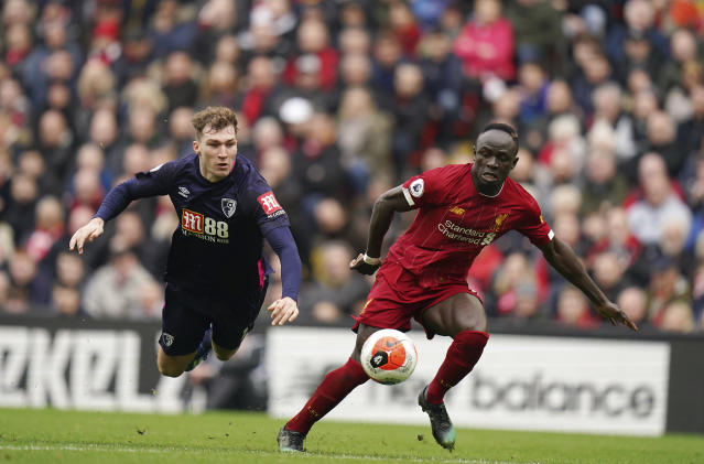 Liverpool's Sadio Mane, right, dribbles past Bournemouth's Jack Stacey during the English Premier League soccer match between Liverpool and Bournemouth at Anfield stadium in Liverpool, England, Saturday, March 7, 2020. (AP Photo/Jon Super)