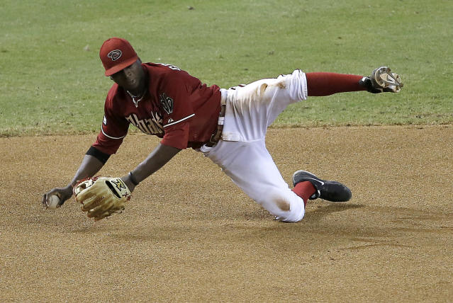 Arizona Diamondbacks' Didi Gregorius cant' get a throw off in time on a base hit by Baltimore Orioles' J.J. Hardy during the 10th inning of a baseball game, Wednesday, Aug. 14, 2013, in Phoenix. (AP Photo/Matt York)