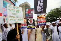 FILE PHOTO: Muslims take part in a protest in Dhaka