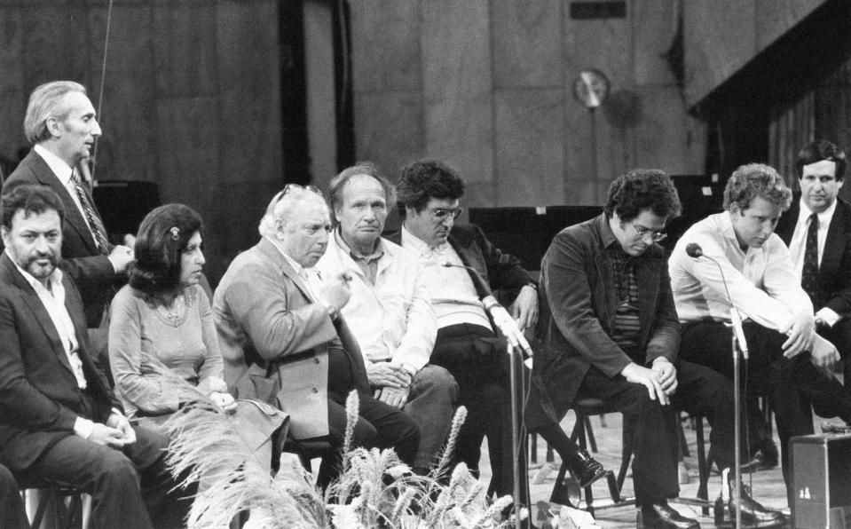 FILE - In this Dec. 19, 1982, file photo Conductor Zubin Mehta, left, with seven of the world greatest violinists Ida Haendal (2nd left), Isaac Stern, Ivry Gitlis, Pinchas Zukerman, Itzhak Perlman and Shlomo Mintz and Dr. Steven Paul, right, during a press conference held in Tel Aviv, Israel. Ivry Gitlis, an acclaimed violinist who played with famed conductors, rock stars and jazz bands around the world and worked to make classical music accessible to the masses, has died in Paris at 98. (AP Photo/Max Nash)