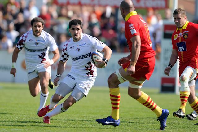 Begles-Bordeaux' Felix Le Bourhis (C) runs with the ball during the French Top 14 rugby union match Begles-Bordeaux vs. Perpignan on May 12, 2012, at the Andre Moga stadium in the French southeastern city of Begles. AFP PHOTO / NICOLAS TUCATNICOLAS TUCAT/AFP/GettyImages