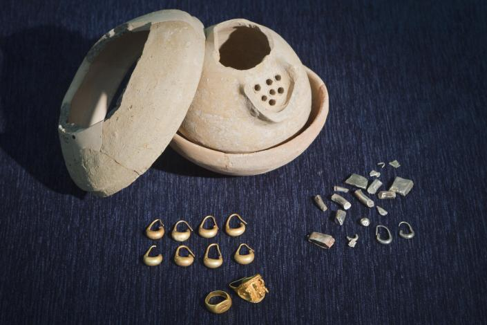 In this photo taken Wednesday, May 23, 2012 ancient jewelry discovered by Israeli archaeologists is displayed at the Tel Aviv University, Israel. Israeli archaeologists have unearthed a stash of rare ancient jewelry near the site of the biblical Armageddon in the north of the country. Israel Finkelstein of Tel Aviv University, who co-directed the dig, said this week that the find offers a rare glimpse into ancient Canaanite high society. The 3,000-year-old jewelry was found inside a ceramic vessel, suggesting the owner hid them before fleeing, he said. (AP Photo/Dan Balilty)