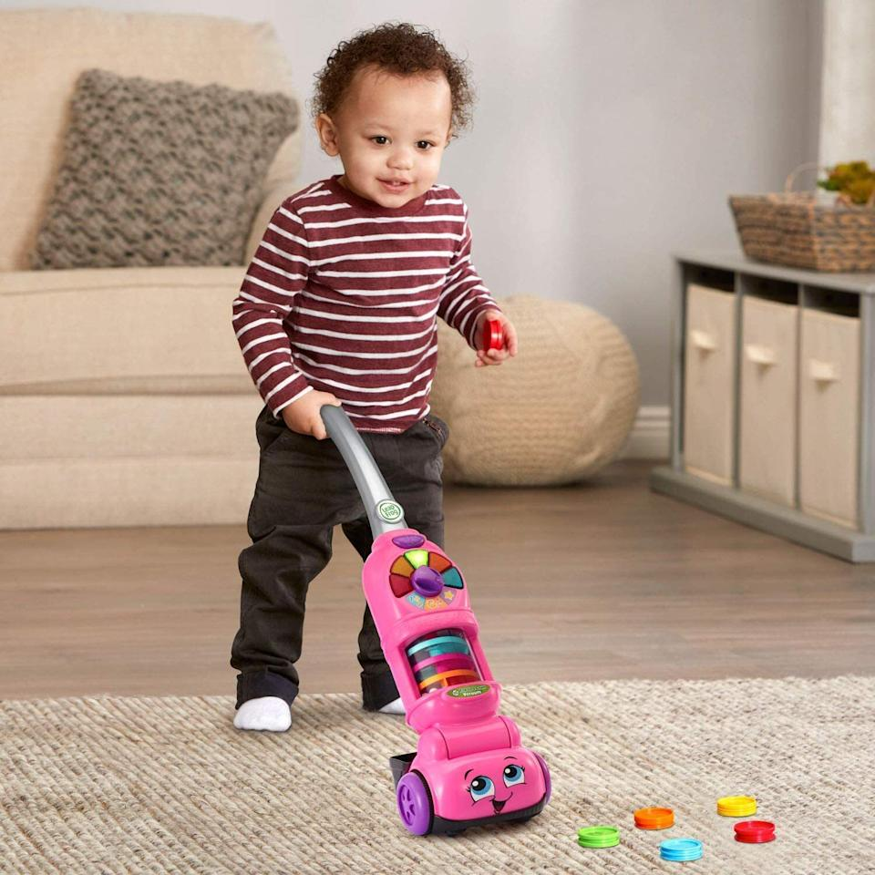 """Teach your toddler to pick up after themself while making it seem like fun with this toy that lights up and has bouncing balls in it. (It does require four <a href=""""https://amzn.to/3dDAbTr"""" target=""""_blank"""" rel=""""noopener noreferrer"""">AA batteries</a>.)<br /><br /><strong>Promising review:</strong>""""I bought it for my son's birthday. So far so good. He obsessed with the vacuum cleaner. This one seems to capture his attention!"""" —<a href=""""https://amzn.to/3najNgm"""" target=""""_blank"""" rel=""""noopener noreferrer"""">Miss t</a><br /><strong><br />Get it from Amazon for<a href=""""https://amzn.to/3axrEzw"""" target=""""_blank"""" rel=""""noopener noreferrer"""">$27.49</a>(available in two colors).</strong>"""