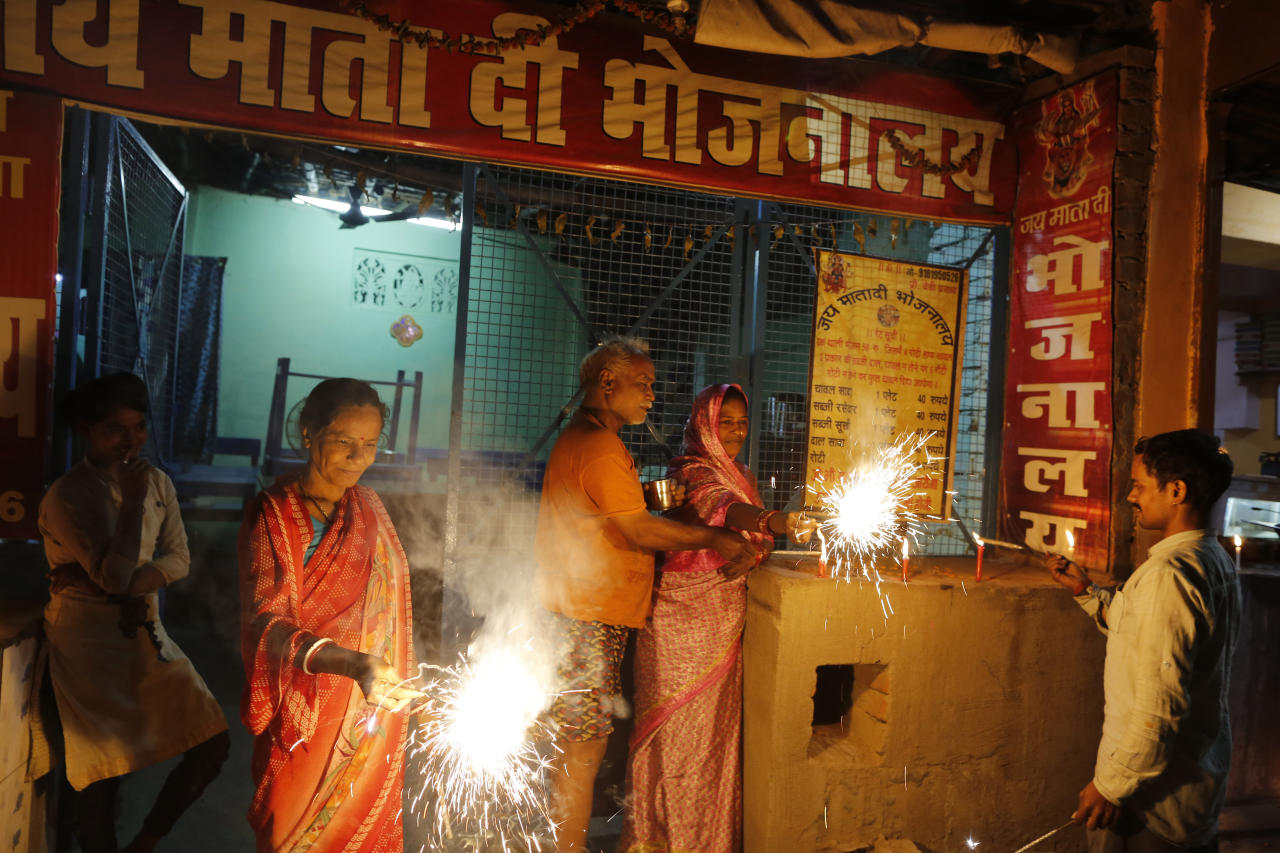 Residents light firecrackers to celebrate the verdict in a decades-old land title dispute between Muslims and Hindus, in Ayodhya, India , Saturday, Nov. 9, 2019. India's Supreme Court on Saturday ruled in favor of a Hindu temple on a disputed religious ground and ordered that alternative land be given to Muslims to build a mosque. The dispute over land ownership has been one of the country's most contentious issues. (AP Photo/Rajesh Kumar Singh)