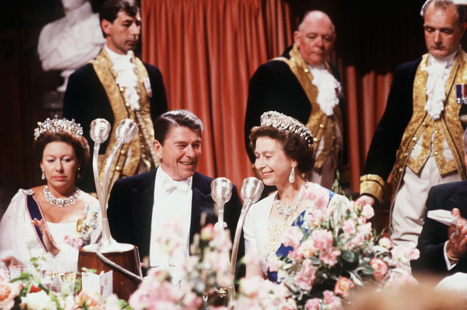WINDSOR, UNITED KINGDOM - JUNE 07:  The Queen Sharing A Joke With President Ronald Reagan During A Banquet At Windsor Castle.  (Photo by Tim Graham Photo Library via Getty Images)