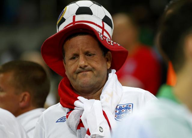 An England fan reacts at the end of the team's 2014 World Cup Group D soccer match against Uruguay at the Corinthians arena in Sao Paulo June 19, 2014. REUTERS/Damir Sagolj (BRAZIL - Tags: SOCIETY SOCCER SPORT WORLD CUP)