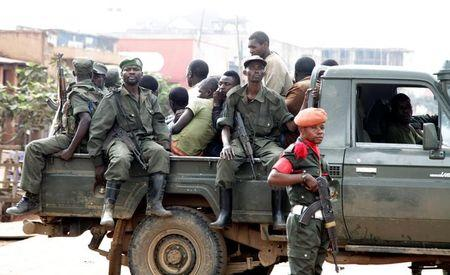Congolese soldiers ride on their pick-up truck after dispersing civilians protesting against the government's failure to stop the killings and inter-ethnic tensions in the town of Butembo