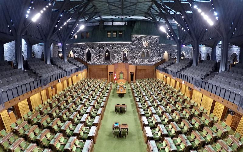 <p>The new chamber for the House of Commons is seen in Ottawa before MPs come together for their first session in the temporary home on Jan. 28. The new glass roof is clearly on display in this image. Photo from The Canadian Press. </p>