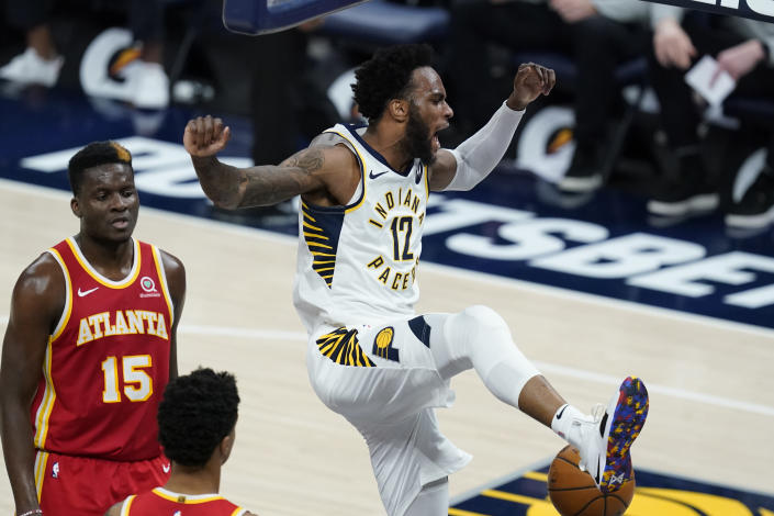 Indiana Pacers' Oshae Brissett (12) reacts after a dunk during the second half of the team's NBA basketball game against the Atlanta Hawks, Thursday, May 6, 2021, in Indianapolis. (AP Photo/Darron Cummings)