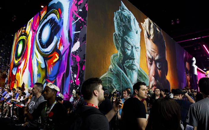 Attendees walk past the Borderlands 3 stand at E3 2019 - Bloomberg