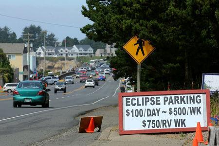 An Entrepreneurial sign for parking is displayed for drivers as they near the small town of Depoe Bay, Oregon as it prepares for the coming Solar Eclipse, August 20, 2017. REUTERS/Mike Blake