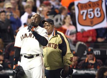 With Willie Mays looking on, Barry Bonds addresses fans after hitting career home run No. 756 on Aug. 7, 2007