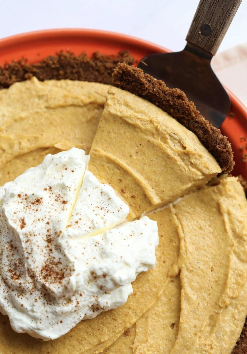 "<p>Light and fluffy, yet filled with flavor, this pumpkin-mousse pie is the sweetest treat of them all. With a cookie-crumb crust and whipped pumpkin topping, you'll be drooling over this before it's even out of the oven.</p> <p><strong>Get the recipe</strong>: <a href=""https://cookiesandcups.com/fluffy-pumpkin-mousse-pie/"" class=""link rapid-noclick-resp"" rel=""nofollow noopener"" target=""_blank"" data-ylk=""slk:fluffy pumpkin-mousse pie"">fluffy pumpkin-mousse pie</a></p>"