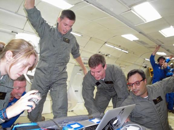 Student engineers Daneesha Kenyon (left), Jack Goodwin (center) and Sam Avery (center right) with the UCSD Microgravity Team study biofuel fires in weightlessness during NASA Microgravity University flight on a ZERO-G flight based out of Elling