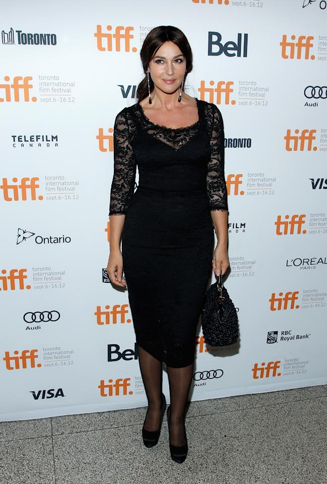 BEST: Monica Belluci shows off her amazing figure in a gorgeous black dress with lace sleeves. The dangling earrings perfectly complete the look.