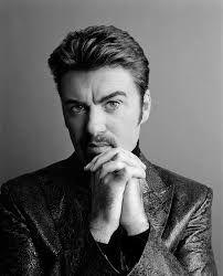 George Michael looks adorable in a fashionable suit with a mind-lowing pose