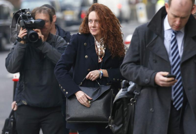 Former News International chief executive Rebekah Brooks arrives at the Old Bailey courthouse in central London December 10, 2013. Coulson is among eight defendants on trial on various charges related to phone-hacking, illegal payments to officials for stories, and hindering police investigations. They all deny the charges linked to a scandal that shook the British establishment. REUTERS/Suzanne Plunkett (BRITAIN - Tags: MEDIA CRIME LAW SOCIETY)