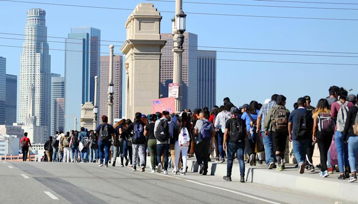 <p>Students from several high schools march to City Hall after walking out of classes to protest the election of Donald Trump as president in downtown Los Angeles Monday, Nov. 14, 2016. (AP Photo/Reed Saxon) </p>