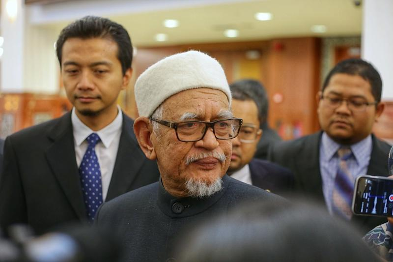 Datuk Seri Hadi Awang speaks to reporters at Parliament lobby October 15, 2019. — Picture by Ahmad Zamzahuri