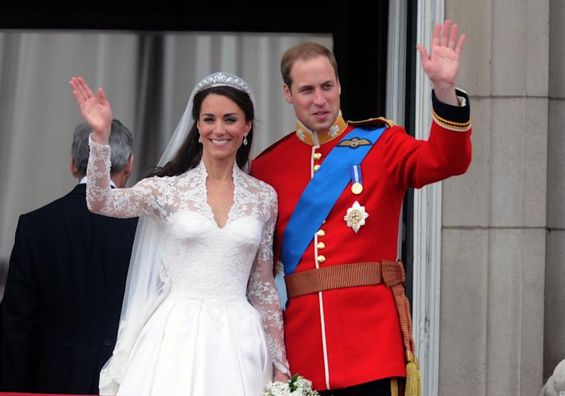 William and Kate wave from the balcony of Buckingham Palace following their wedding on April 29, 2011 [Photo: PA]