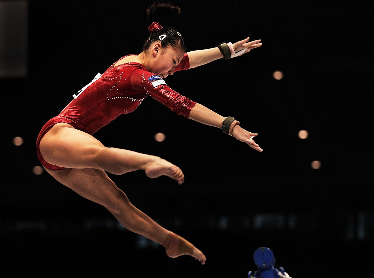 TOKYO, JAPAN - OCTOBER 08: He Kexin of China competes on the Uneven Bars aparatus in the Women's qualification during day two of the Artistic Gymnastics World Championships Tokyo 2011 at Tokyo Metropolitan Gymnasium on October 8, 2011 in Tokyo, Japan.  (Photo by Adam Pretty/Getty Images)