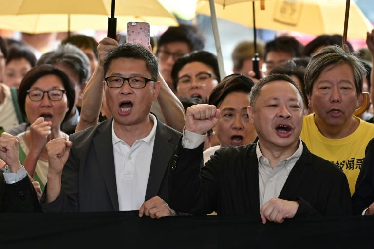 Law professor Benny Tai (R) and sociology professor Chan Kin-man (L) were two of the leaders jailed
