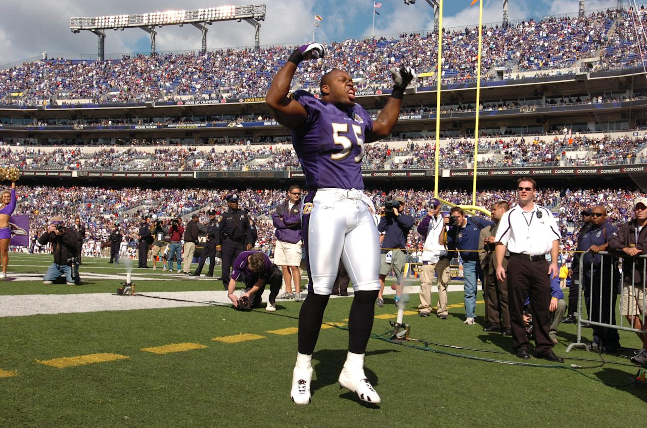 Defensive end Terrell Suggs #55 of the Baltimore Ravens pumps up the crowd against the Cleveland Browns at M&T Bank Stadium on October 16, 2005 in Baltimore, Maryland. The Ravens defeated the Browns 16-3. (Photo by Larry French/Getty Images)