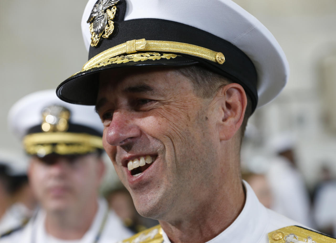 Commander of Naval Operations, Adm. John Richardson, speaks to reporters aboard the nuclear aircraft carrier USS Gerald R. Ford at Naval Station Norfolk in Norfolk, Va., Saturday, July 22, 2017. The ship will be commissioned by President Donald Trump later today. (AP Photo/Steve Helber)