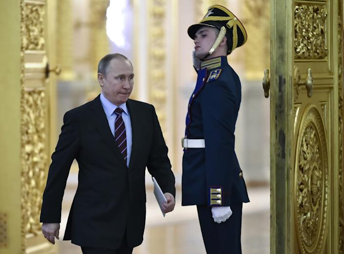 Russian President Vladimir Putin arrives to chair a meeting of the Pobeda (Victory) Organizing Committee in the Kremlin