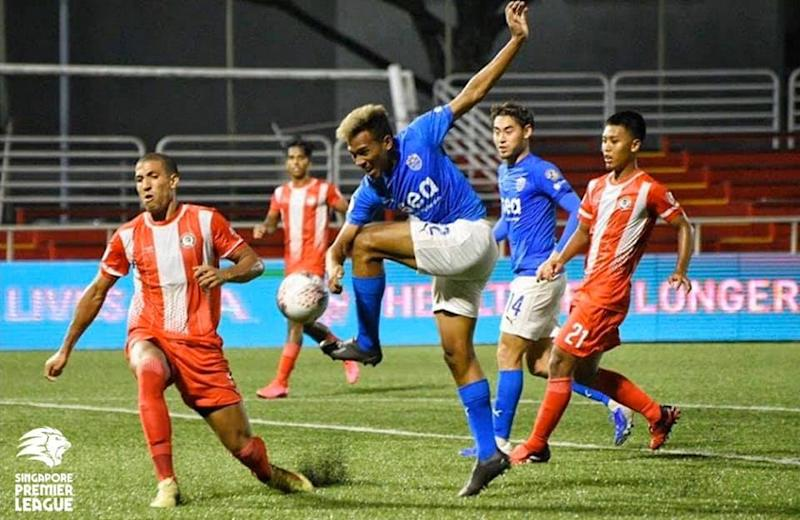 Lion City Sailors' Iqram Rifiqi (blue jersey) tussling for the ball with Tanjong Pagar players during their 1-1 Singapore Premier League draw at Jurong East Stadium. (PHOTO: Singapore Premier League/Facebook)