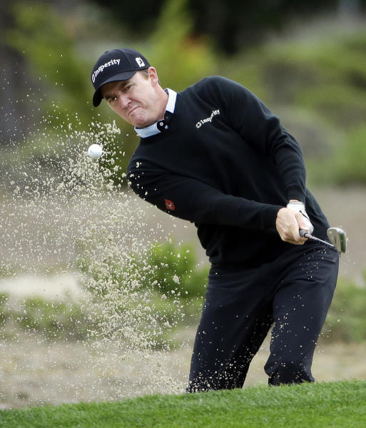 Jimmy Walker hits out of a sand trap on the fifth hole Saturday, Feb. 8, 2014, during the third round of the AT&T Pebble Beach Pro-Am golf tournament on the Monterey Peninsula Country Club Shore Course in Pebble Beach, Calif. (AP Photo/Ben Margot)