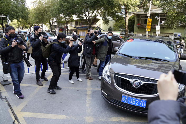 A car that's part of a convoy carrying the World Health Organization team of researchers arrives at the Hubei Provincial Hospital of Integrated Chinese and Western Medicine also know as the Hubei Province Xinhua Hospital in Wuhan in central China's Hubei province on Friday, Jan. 29, 2021. The World Health Organization team of researchers emerged from their hotel Thursday for the first time since their arrival in the central Chinese city of Wuhan to start searching for clues into the origins of the COVID-19 pandemic. (AP Photo/Ng Han Guan)