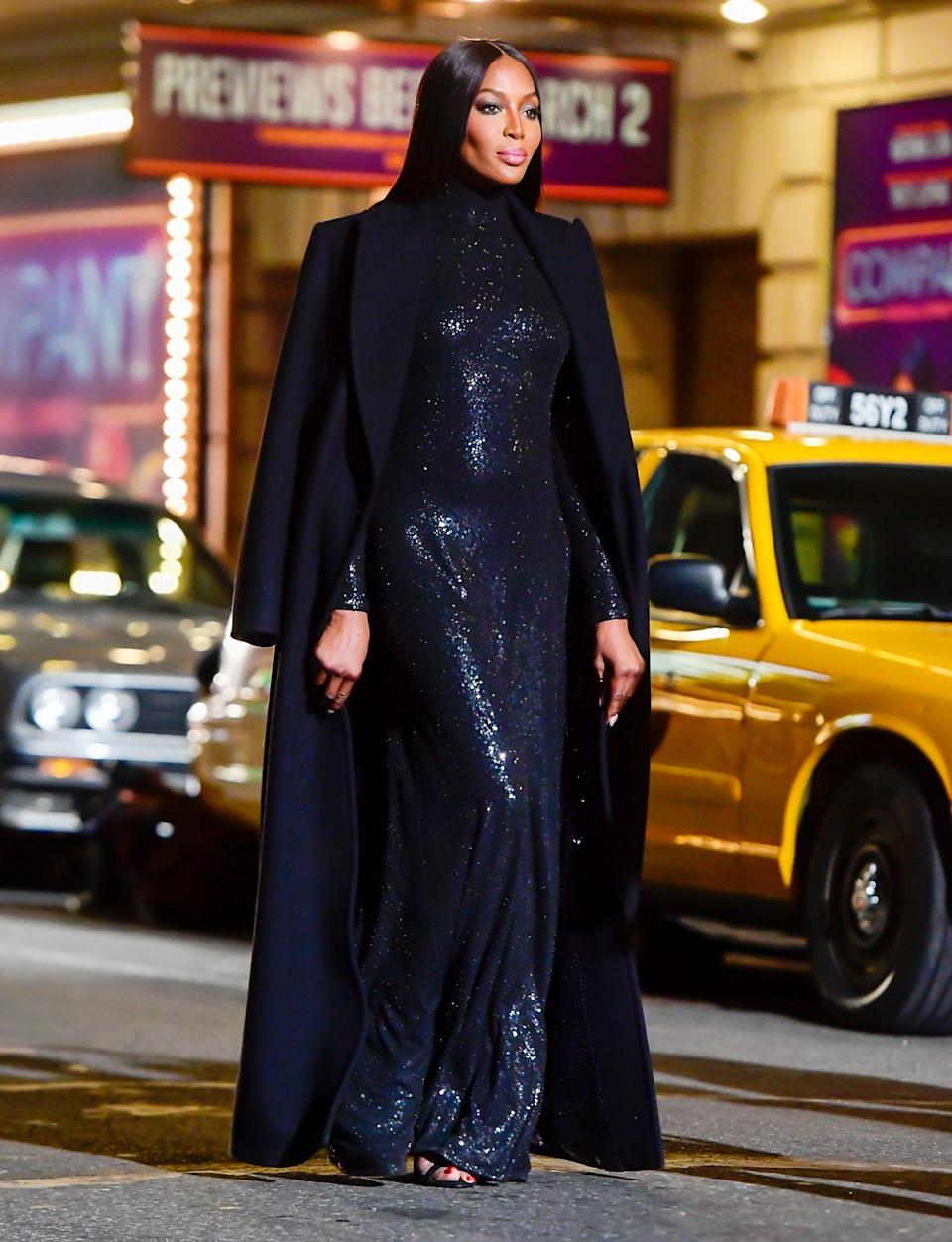 <p>Naomi Campbell steals the spotlight as she walks through Times Square in the Michael Kors fashion show on Thursday in N.Y.C.</p>