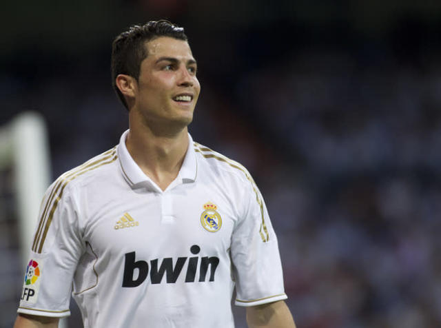 Real Madrid's Portuguese forward Cristiano Ronaldo smiles during the Spanish league football match Real Madrid vs Mallorca on May 13, 2012 at the Santiago Bernabeu stadium in Madrid. AFP PHOTO/ Jaime REINAJAIME REINA/AFP/GettyImages
