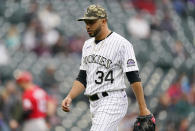 Colorado Rockies relief pitcher Jordan Sheffield heads to the dugout after striking out Cincinnati Reds' Tyler Stephenson to end the top of the ninth inning of a baseball game Sunday, May 16, 2021, in Denver. (AP Photo/David Zalubowski)