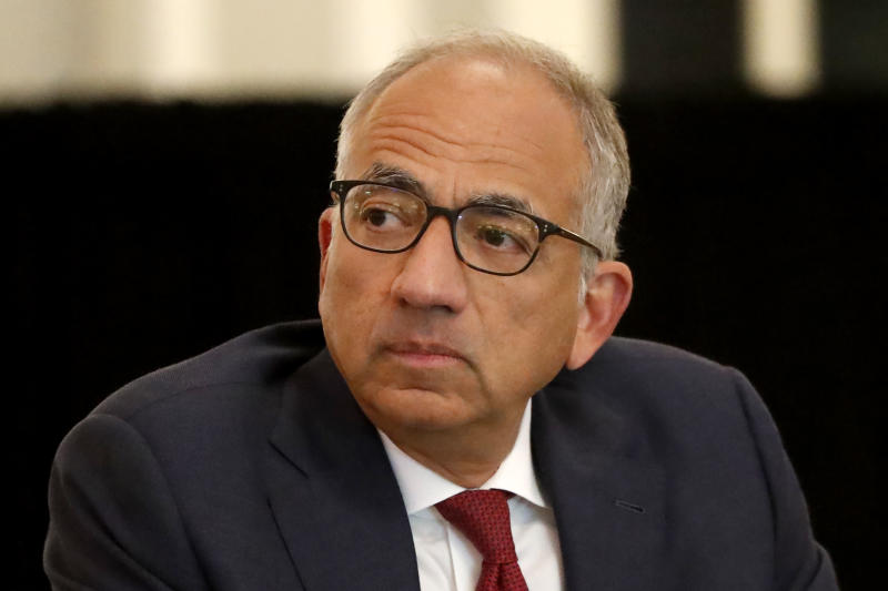 U.S. Soccer President Carlos Cordeiro presides over a meeting of the U.S. Soccer Board of Directors Friday, Dec. 6, 2019, in Chicago. (AP Photo/Charles Rex Arbogast)