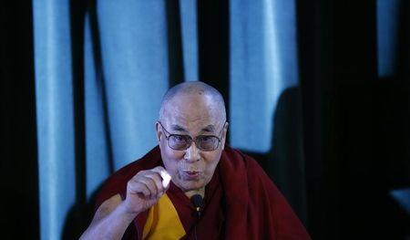 Tibetan spiritual leader, the Dalai Lama speaks during a news conference at Magdalene College in Oxford