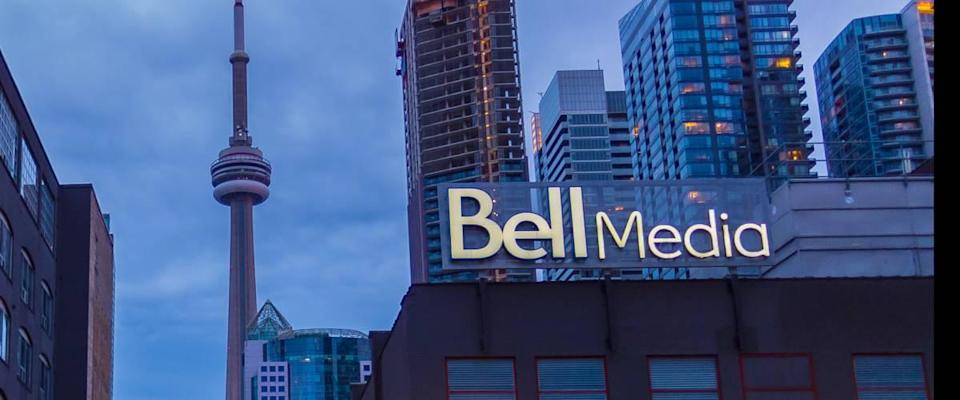 Bell Media with the CN Tower in the background in Downtown Toronto at night